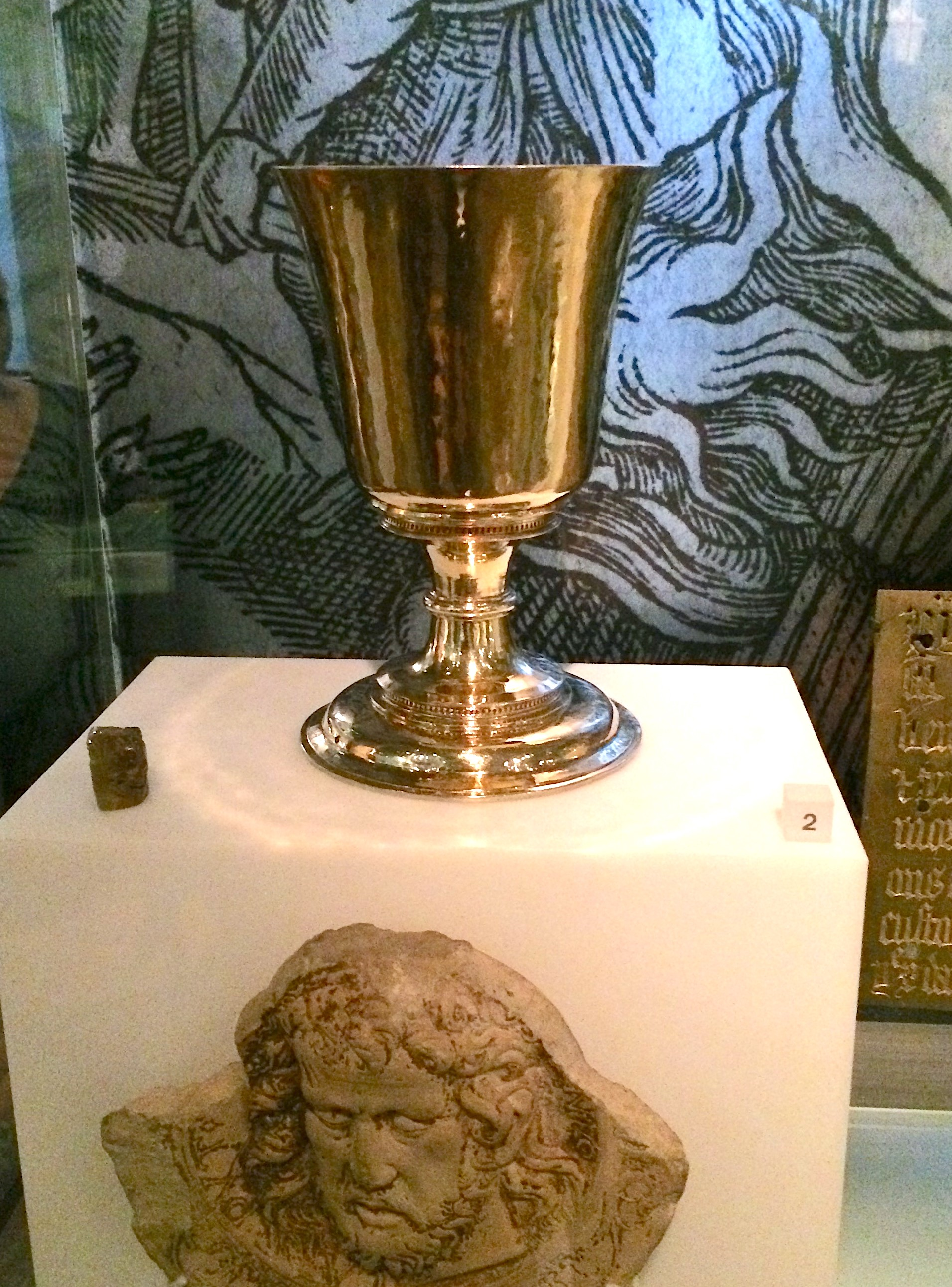 A gold chalice on display at the Museum of London