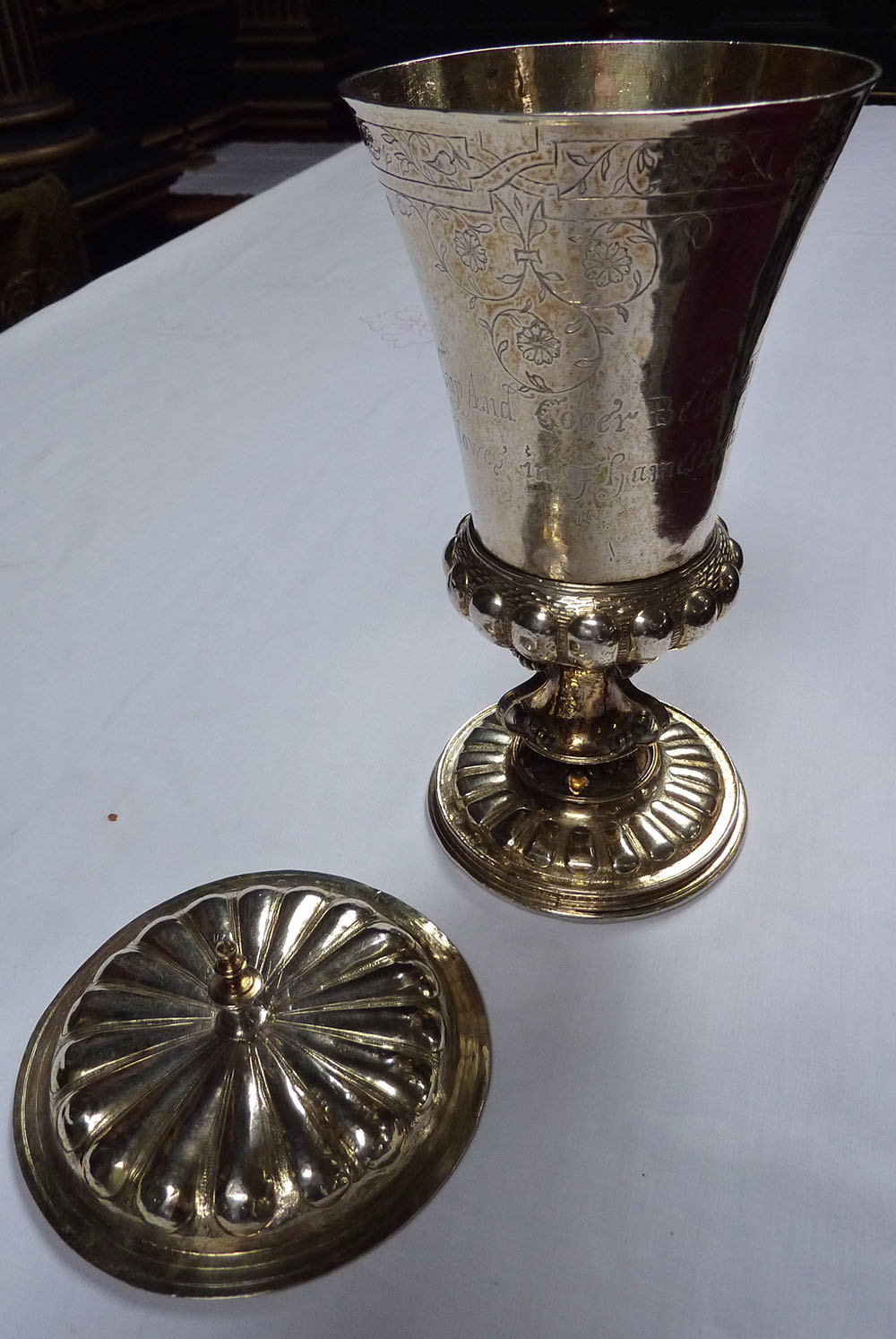 A 1575 brass coloured chalice with an ornate lid